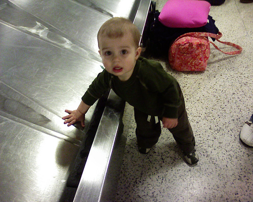 Child on baggage carousel