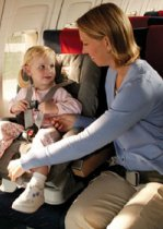 Child with Mother in child restraint system on a plane